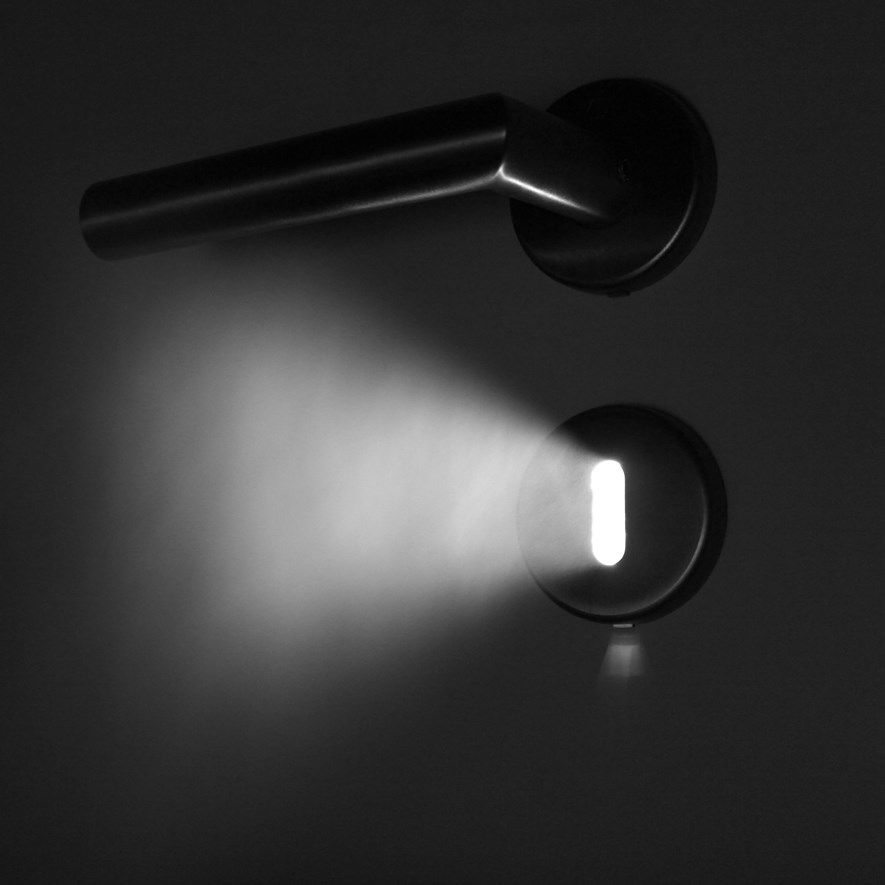 Light shining through keyhole and steam.