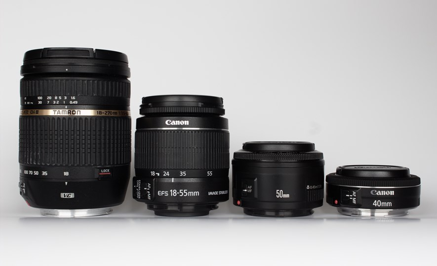 From the left: Tamron 18-270 3.5-6.3 DI II VC,  Canon EF-S 18-55mm f/3.5-5.6 IS II (kit lens), Canon EF 50mm 1:1.8 II and the Canon EF 40mm f/2.8. The Tamron and the kit lens are both zoom lenses, while the 40mm and the 50mm are primes.