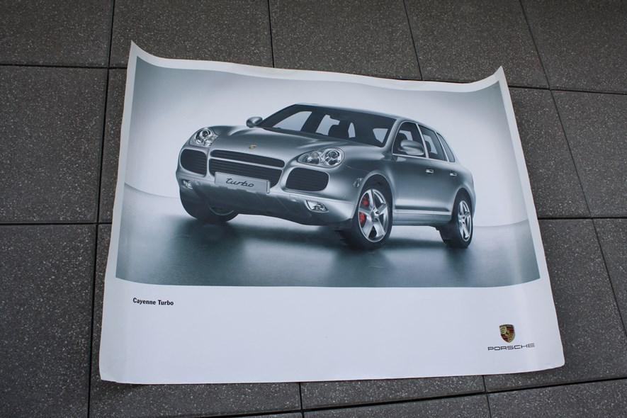 Got this poster for free from the Porsche museum in Stuttgart. Any poster will do though.