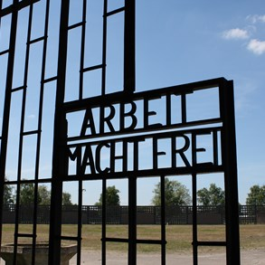 "At the Sachsenhausen concentration camp. The sign reads ""Work liberates""."