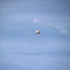 F-18 Hornet dropping flares.