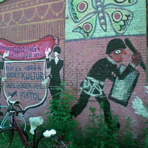"Christiania. It's still 1970 around here. On the wall: ""When I hear the word culture, I release the safety of my gun."""